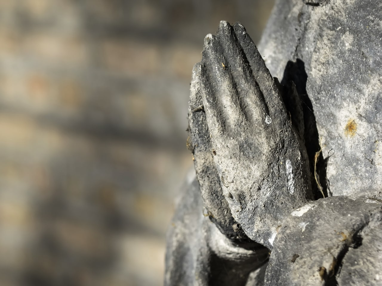 Statue with praying hands